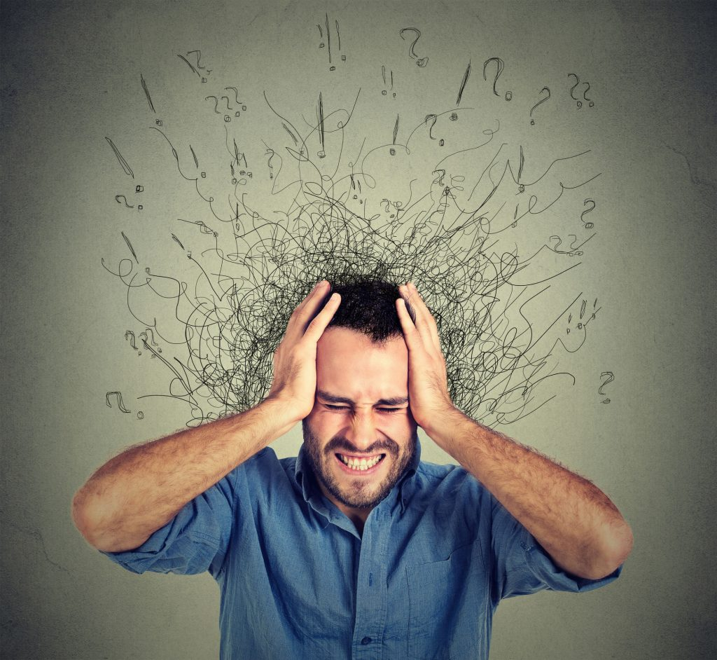 51742552 - stressed man upset frustrated has too many thoughts with brain melting into lines question marks. obsessive compulsive, adhd, anxiety disorder. negative human emotions face expression feelings