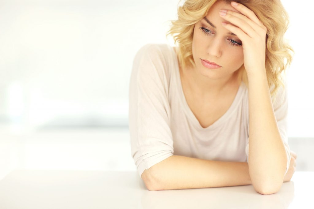 39577332 - a picture of a young depressed woman with headache at home