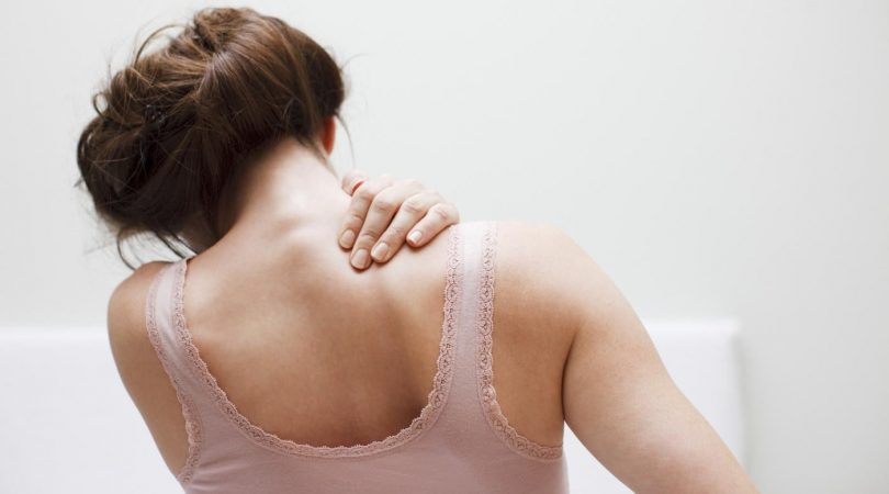 Pain in arms and shoulder due to scoliosis.